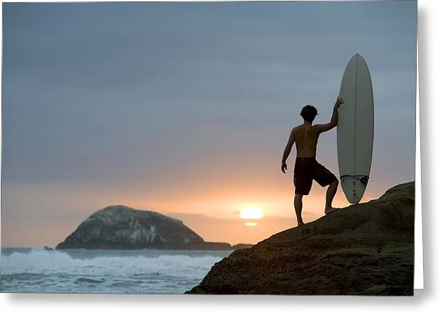 Free Of Peace Greeting Cards - A Surfer On Muriwai Beach New Zealand Greeting Card by Deddeda