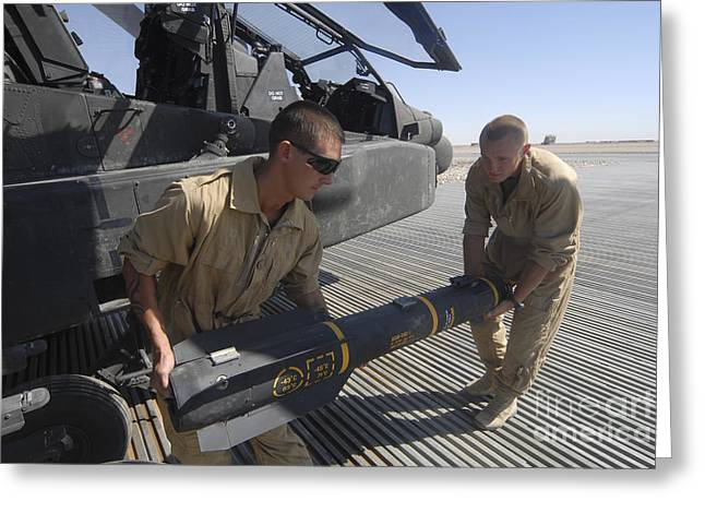 Aircrew Greeting Cards - Aircrew Loading An Agm-114 Hellfire Greeting Card by Andrew Chittock