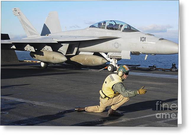 Military Airplanes Greeting Cards - An Fa-18f Super Hornet Prepares Greeting Card by Stocktrek Images