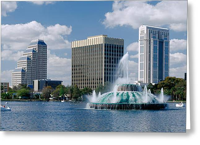 Swans... Greeting Cards - Buildings At The Waterfront, Lake Eola Greeting Card by Panoramic Images