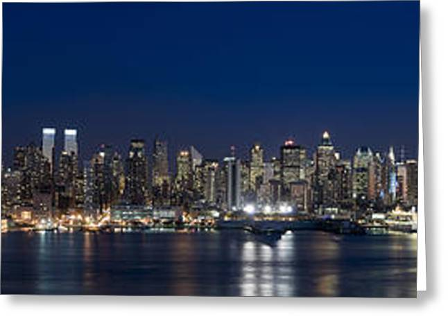 Midtown Greeting Cards - Buildings In A City Lit Up At Dusk Greeting Card by Panoramic Images