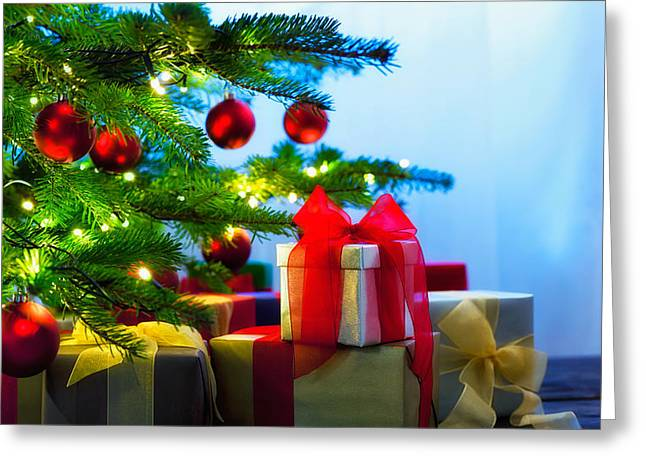 Candle Lit Greeting Cards - Christmas tree decorated with presents Greeting Card by Ulrich Schade