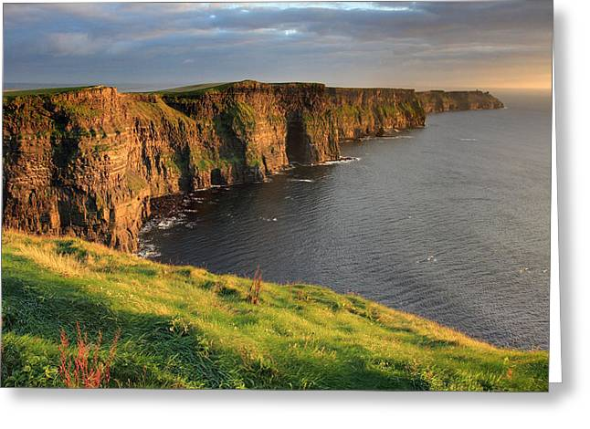 Glow Photographs Greeting Cards - Cliffs of Moher sunset Ireland Greeting Card by Pierre Leclerc Photography