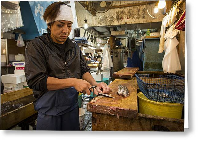 Fishmongers Greeting Cards - Fishmonger cutting a fish in Tsukiji Fish Market Greeting Card by Ruben Vicente