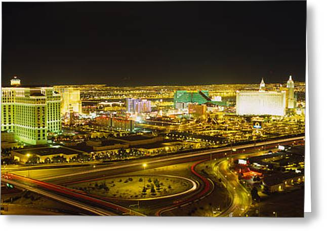 Crossroads Greeting Cards - High Angle View Of Buildings Lit Greeting Card by Panoramic Images