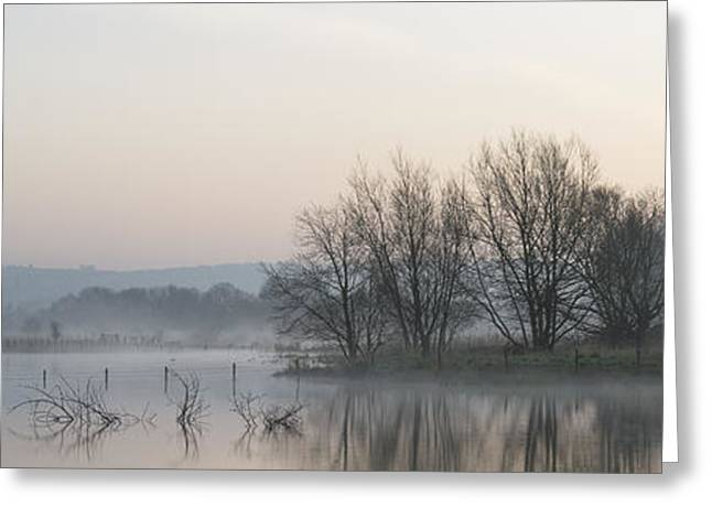 Panorama landscape of lake in mist with sun glow at sunrise Greeting Card by Matthew Gibson