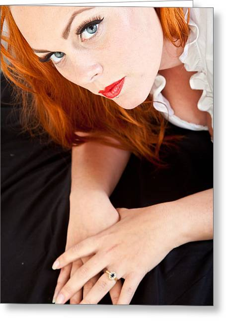 False Expressions Greeting Cards - Red hair girl in pin-up style portrait shot in studio Greeting Card by Jean Schweitzer