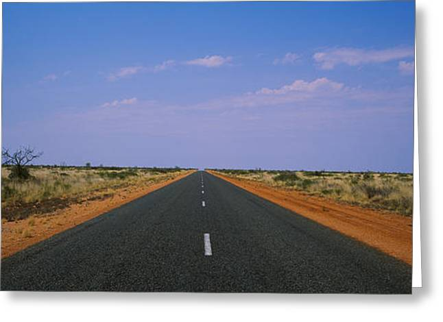 Arid Country Greeting Cards - Road Passing Through A Landscape Greeting Card by Panoramic Images