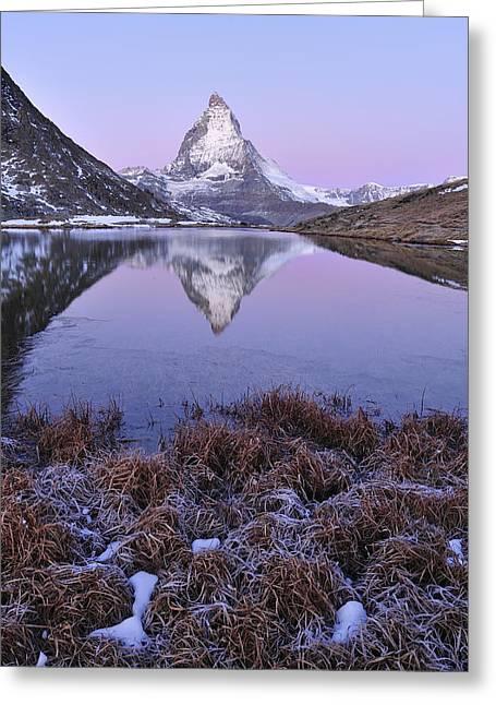 Thomas Marent Greeting Cards - The Matterhorn And Riffelsee Lake Greeting Card by Thomas Marent