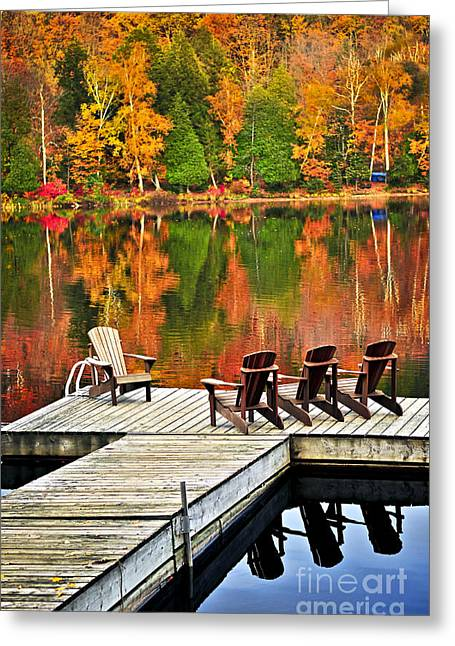 Chairs Greeting Cards - Wooden dock on autumn lake Greeting Card by Elena Elisseeva