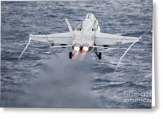 Military Airplanes Greeting Cards - An Fa-18c Hornet Launches Greeting Card by Stocktrek Images
