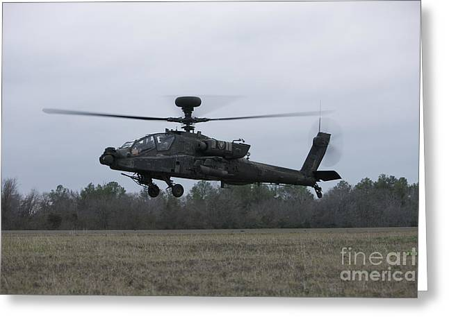 Taking The Field Greeting Cards - An Ah-64 Apache Helicopter In Midair Greeting Card by Terry Moore
