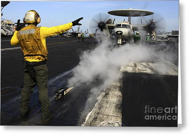 Flight Operations Photographs Greeting Cards - Aviation Boatswains Mate Directs An Greeting Card by Stocktrek Images