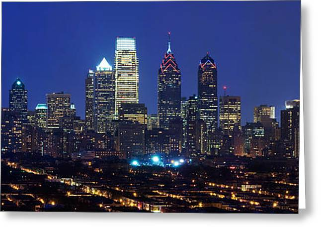 Illuminate Greeting Cards - Buildings Lit Up At Night In A City Greeting Card by Panoramic Images