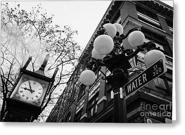 Streetlight Greeting Cards - old steam powered clock on water street in the historic gastown district Vancouver BC Canada Greeting Card by Joe Fox