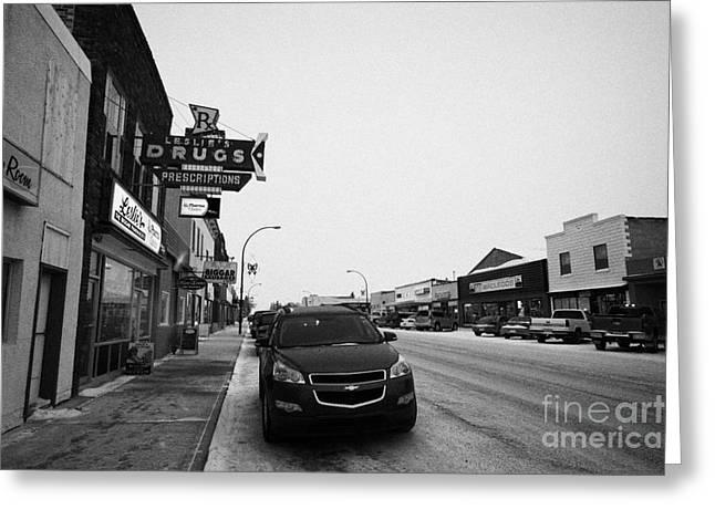 Main Street Greeting Cards - shops and stores on the main street Biggar Saskatchewan Canada in winter Greeting Card by Joe Fox