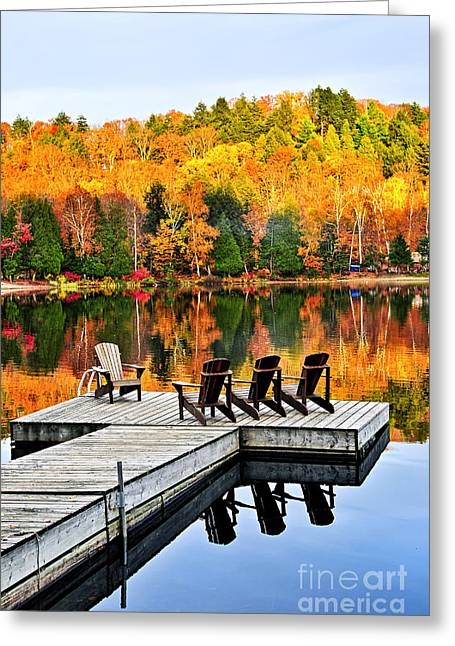 Yellow Reflections Greeting Cards - Wooden dock on autumn lake Greeting Card by Elena Elisseeva