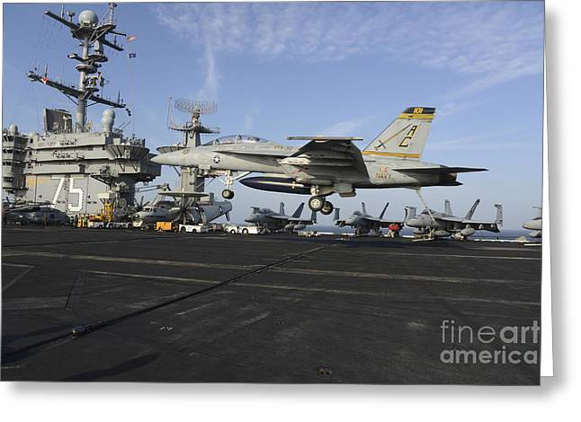 Military Airplanes Greeting Cards - An Fa-18f Super Hornet Lands Greeting Card by Stocktrek Images
