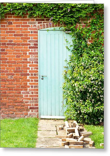 Blue Brick Greeting Cards - Blue door Greeting Card by Tom Gowanlock