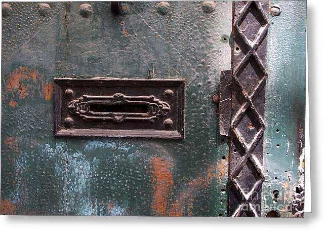 Cracked Photographs Greeting Cards - Door with peeling paint Greeting Card by Bernard Jaubert