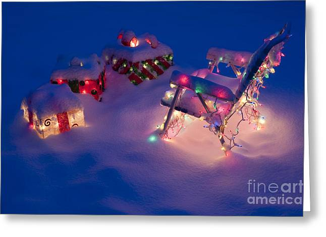 Lawn Chairs With Lit Christmas Presents Greeting Card by Jim Corwin