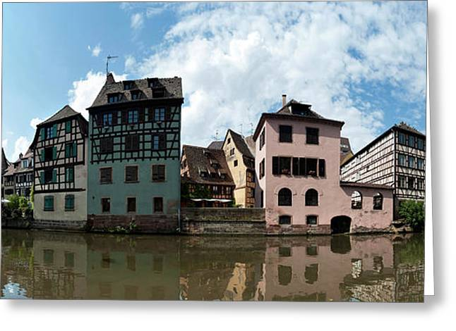 Reflection Of Buildings On Water Greeting Card by Panoramic Images