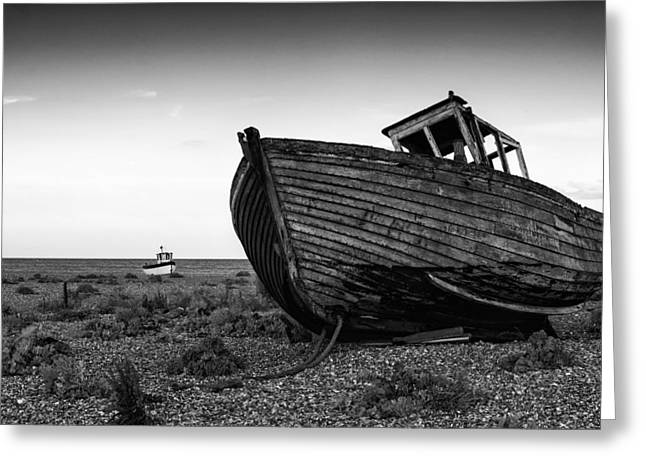 Wooden Building Greeting Cards - Stunning black and white image of abandoned boat on shingle beac Greeting Card by Matthew Gibson