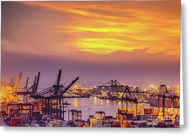 Town Pier Greeting Cards - Container Cargo freight ship with working crane bridge in shipya Greeting Card by Anek Suwannaphoom