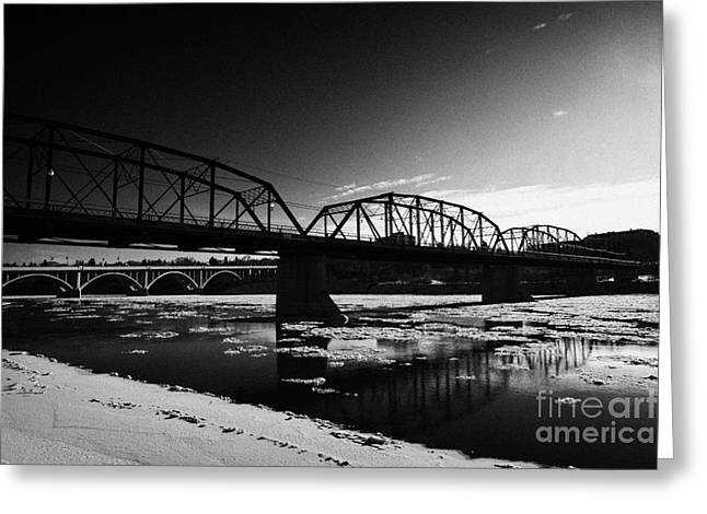 Old North Bridge Greeting Cards - the old traffic bridge over the south saskatchewan river in winter flowing through downtown Saskatoo Greeting Card by Joe Fox