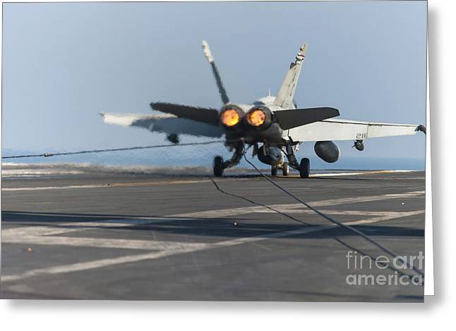 Military Airplanes Greeting Cards - An Fa-18c Hornet Lands On The Flight Greeting Card by Stocktrek Images
