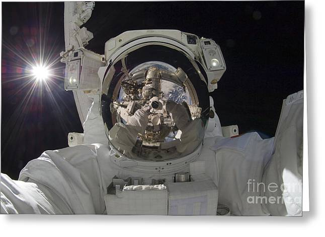 Self-portrait Photographs Greeting Cards - Astronaut Uses A Digital Still Camera Greeting Card by Stocktrek Images