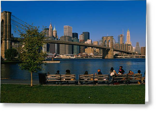 Brooklyn Bridge Park Greeting Cards - Suspension Bridge Across A River Greeting Card by Panoramic Images