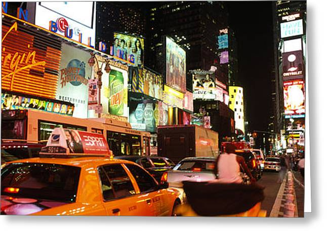 Night Scenes Greeting Cards - Buildings Lit Up At Night In A City Greeting Card by Panoramic Images