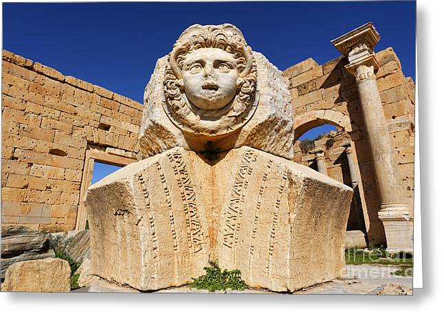 Medusa Greeting Cards - Sculpted Medusa head at the Forum of Severus at Leptis Magna in Libya Greeting Card by Robert Preston