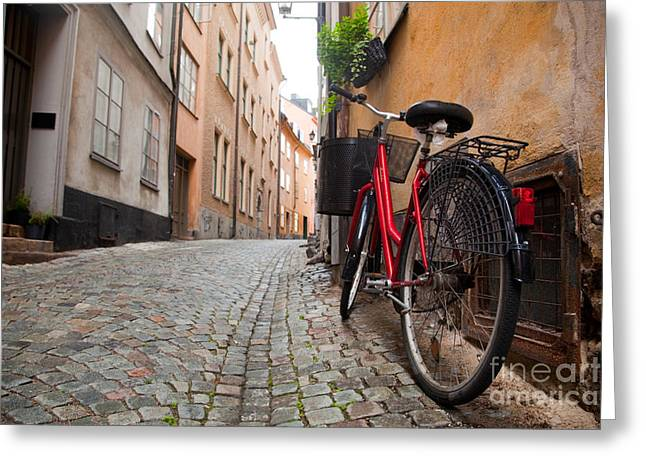 Town Walls Greeting Cards - A bike in the old town of stockholm Greeting Card by Michal Bednarek