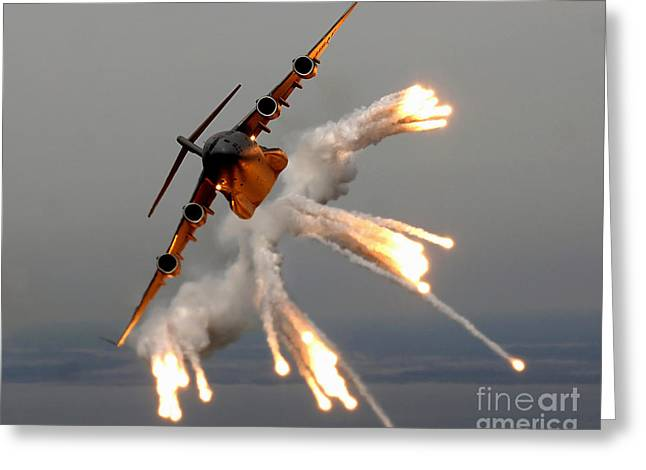 Cargo Greeting Cards - A C-17 Globemaster Iii Releases Flares Greeting Card by Stocktrek Images