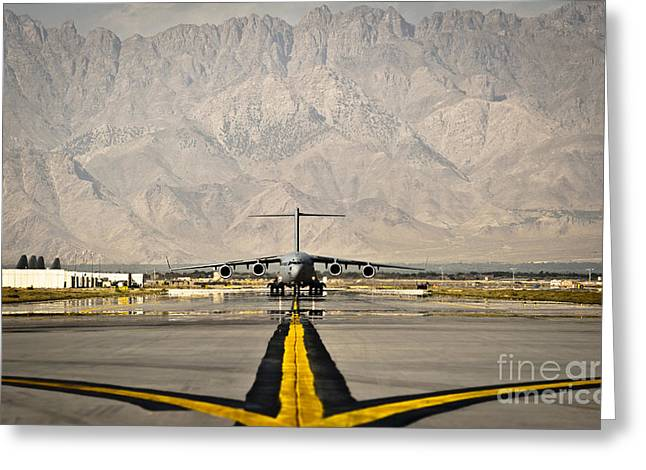 Airfield Greeting Cards - A C-17 Globemaster Iii Taxis Greeting Card by Stocktrek Images