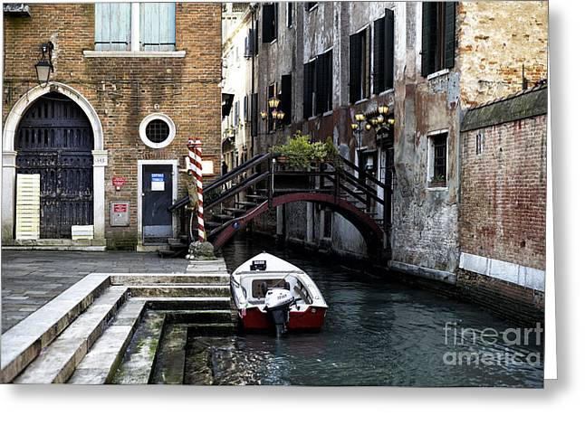 Boats On Water Greeting Cards - A Canal in Venice Greeting Card by John Rizzuto