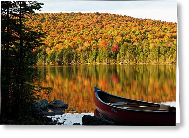 A Canoe On The Shoreline Of Pond Greeting Card by Jerry and Marcy Monkman