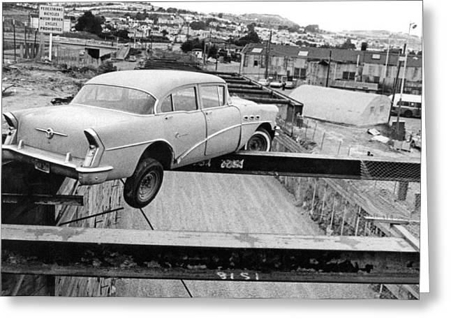 A Car Precariously Balanced Greeting Card by Underwood Archives