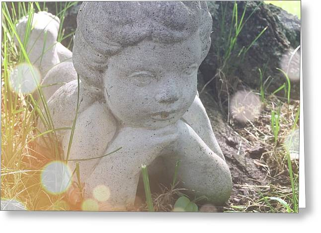 Cherub Greeting Cards - A cherub angel in the grass Greeting Card by Amy Cicconi