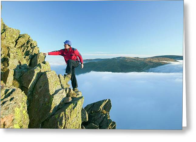A Climber On Red Screes Greeting Card by Ashley Cooper