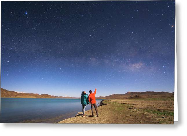 A Couple Enjoys A Romantic Moment Greeting Card by Jeff Dai