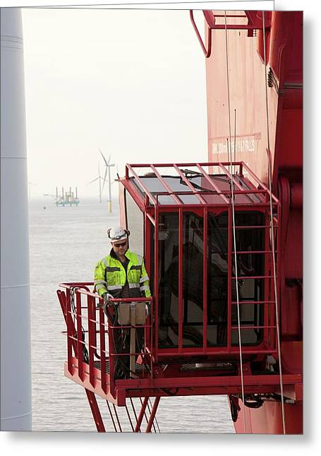 A Crane Operator On The Jack Up Barge Greeting Card by Ashley Cooper