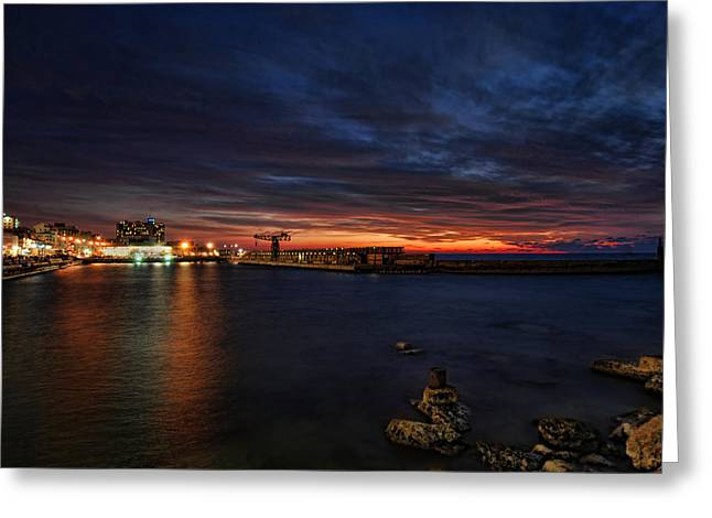 a flaming sunset at Tel Aviv port Greeting Card by Ron Shoshani