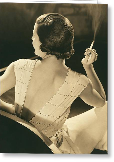 A Glamourous Woman Smoking Greeting Card by Underwood Archives