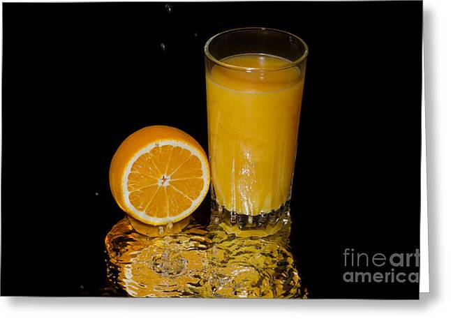 Beverage Pyrography Greeting Cards - A glass of juice in the liquid Greeting Card by Konstantin Smirnov