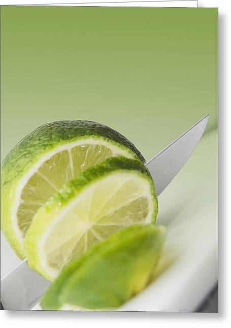 Butcher Knife Greeting Cards - A Knife Cutting A Lime Greeting Card by Marlene Ford