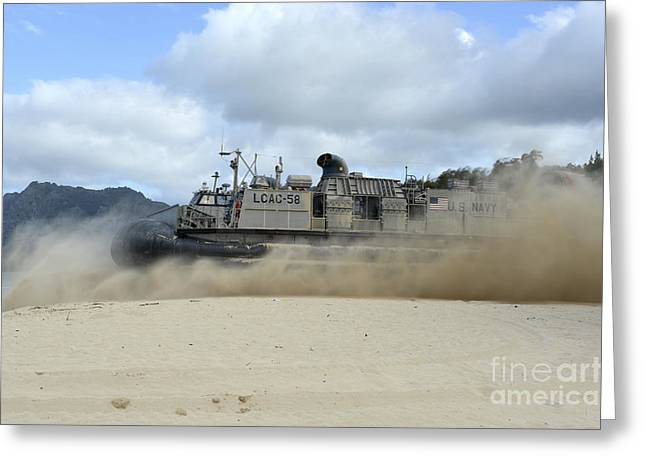 On The Beach Greeting Cards - A Landing Craft Air Cushion Departs Greeting Card by Stocktrek Images