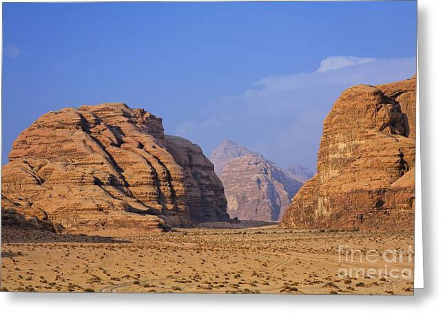 Jordan Photographs Greeting Cards - A landscape of rocky outcrops in the desert of Wadi Rum in Jordan Greeting Card by Robert Preston
